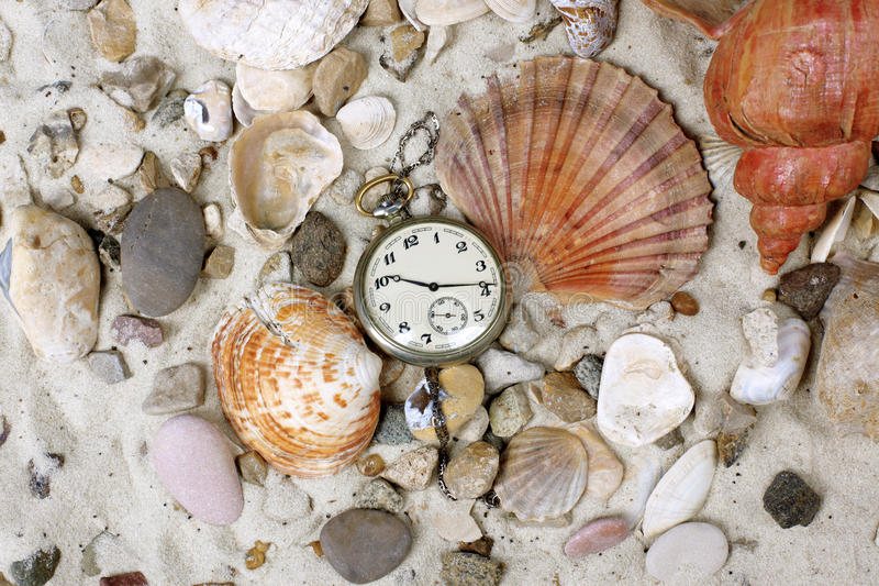 Download Sea Shells And Vintage Clock On Sand Stock Photo - Image: 13307174