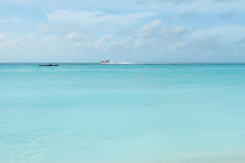 Sea and ship and plane in tropical island royalty free stock photography