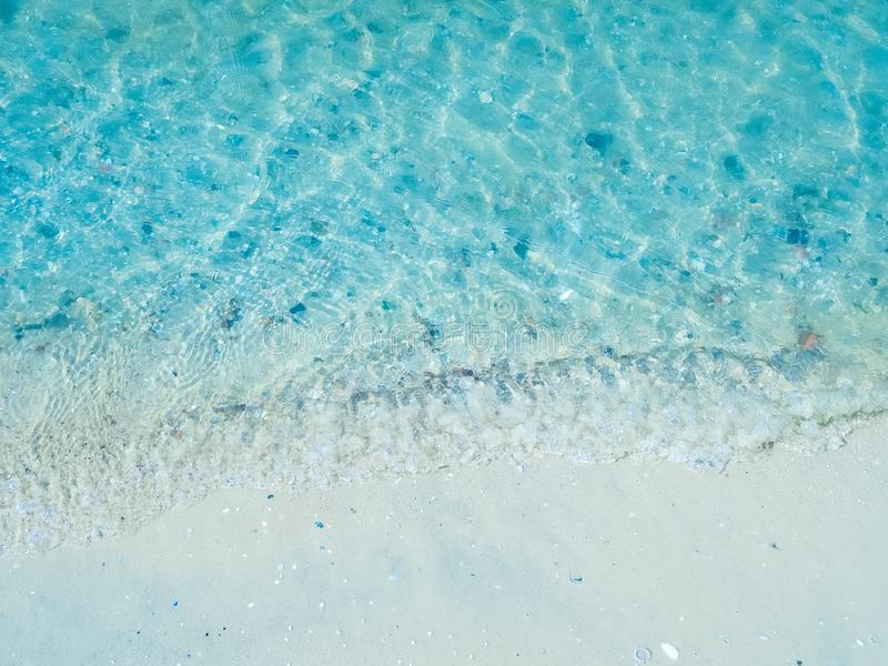 Sea shore - a beach with white sand. Shells and stones stock image