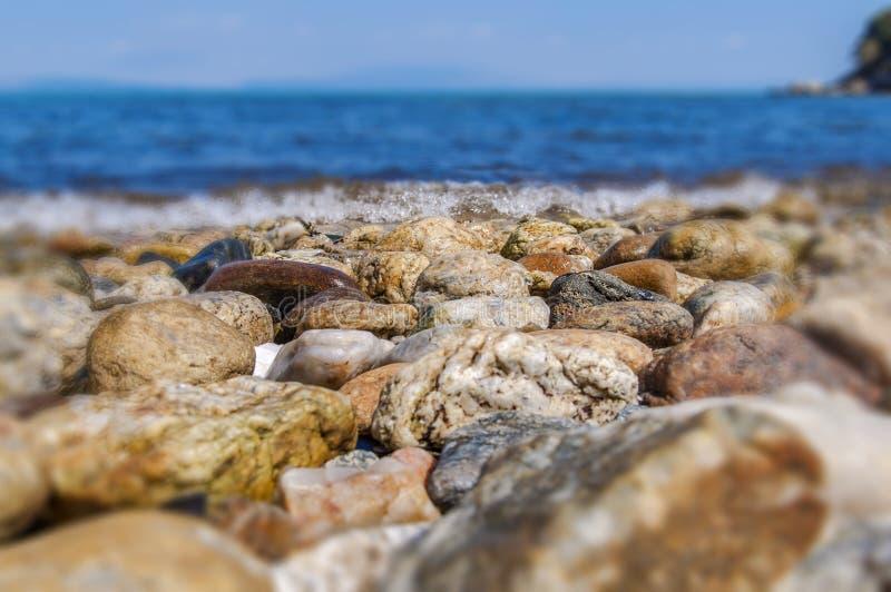 Sea shore stone blurr wave background. Close stock images