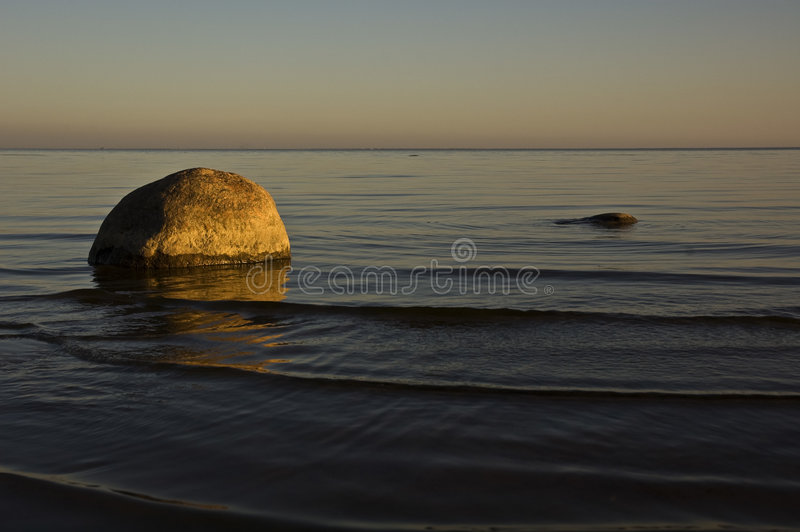 Sea shore in a sunset. royalty free stock photography