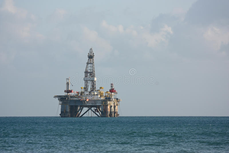 Sea side oil rig. An oil rig parked at the nautical area of Cyprus due to problems in Egypt which it was supposed to be going to stock images