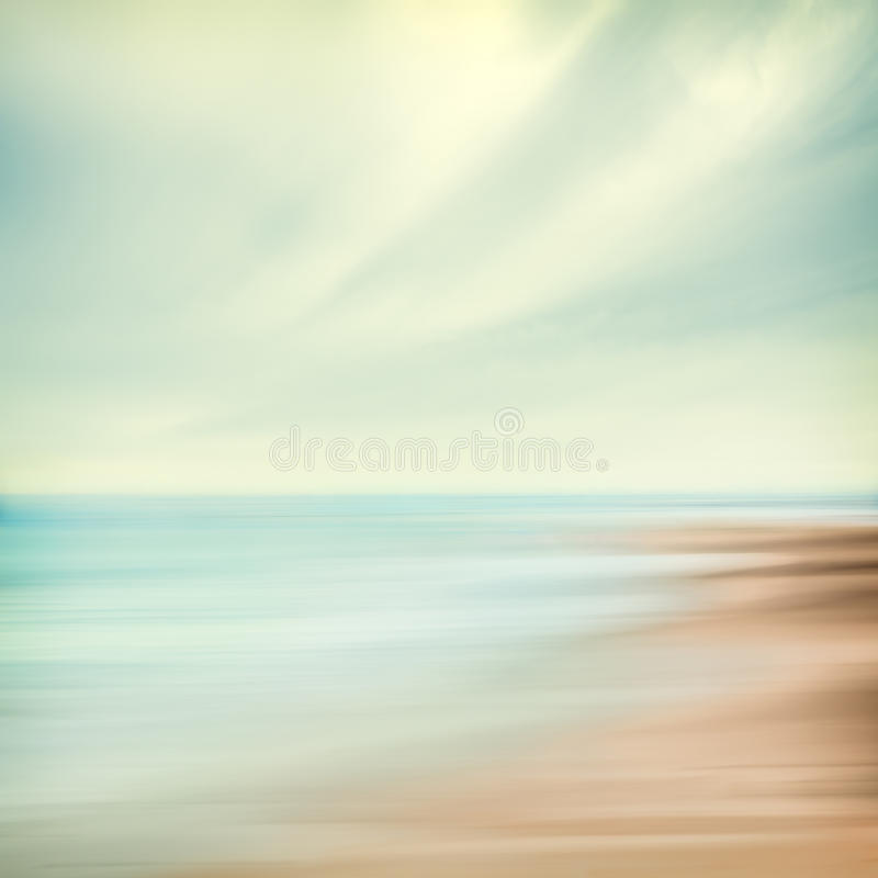 Sea and Sky Abstract. A seascape abstract with panning motion combined with a long exposure. Image displays soft, pastel colors in a retro style stock image