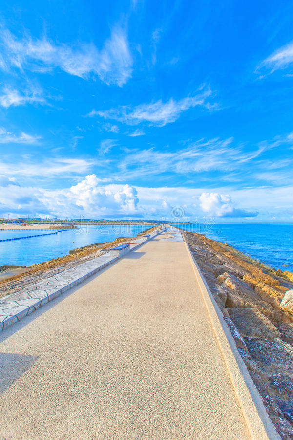 Sea, sky and benches royalty free stock photos