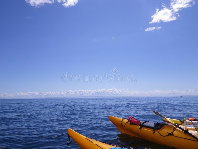 Sea, Sky, Boat, Kayak royalty free stock images