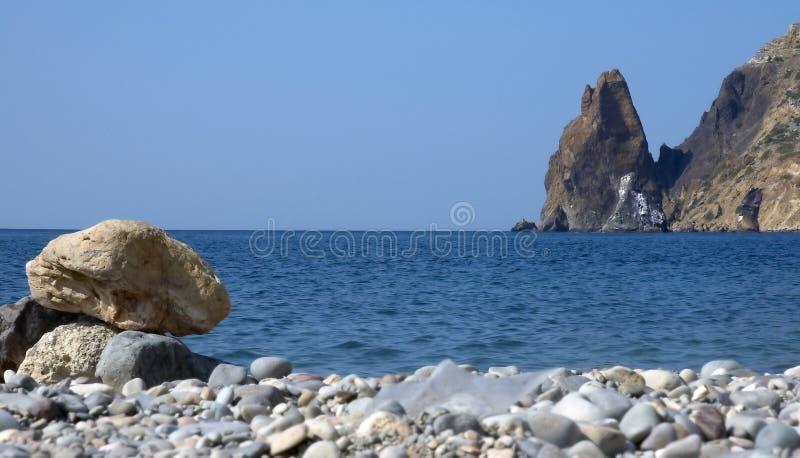 Sea, sky and rocks stock photo