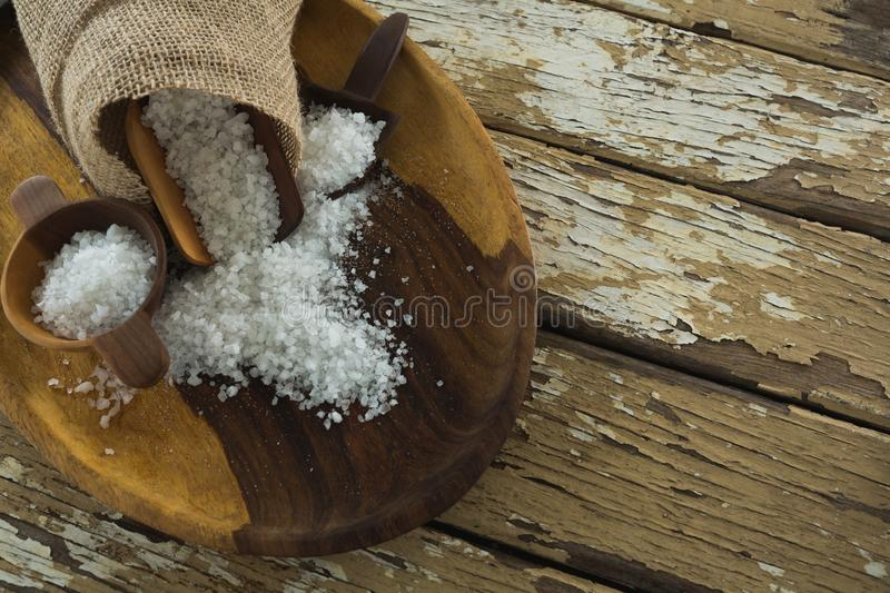 Sea slat on wooden plate. Close-up of sea slat on wooden plate stock image