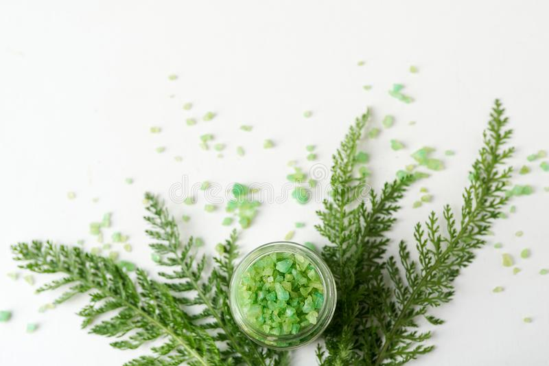 Sea solt with greenery on white background with copy space. mockup . bath spa concept flat lay.  royalty free stock photo