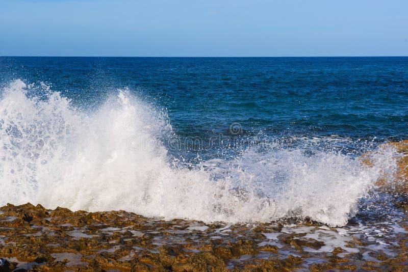 Download Sea splashing on rocks stock photo. Image of landscape - 83702876