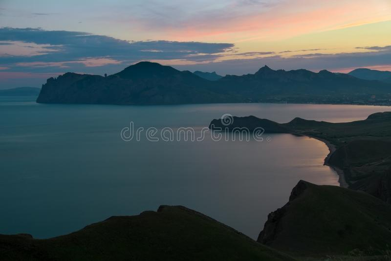 Sea spring bay at sunset. View from the mountain. Nature composition royalty free stock photos