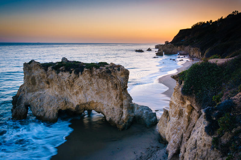 Sea stack and view of the Pacific Ocean at sunset, from cliffs a royalty free stock photography