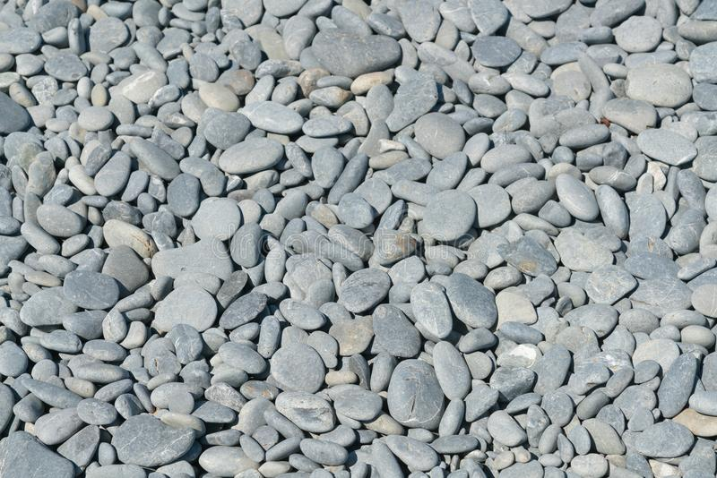 Sea stone pebble on ground. Background and texture royalty free stock photography