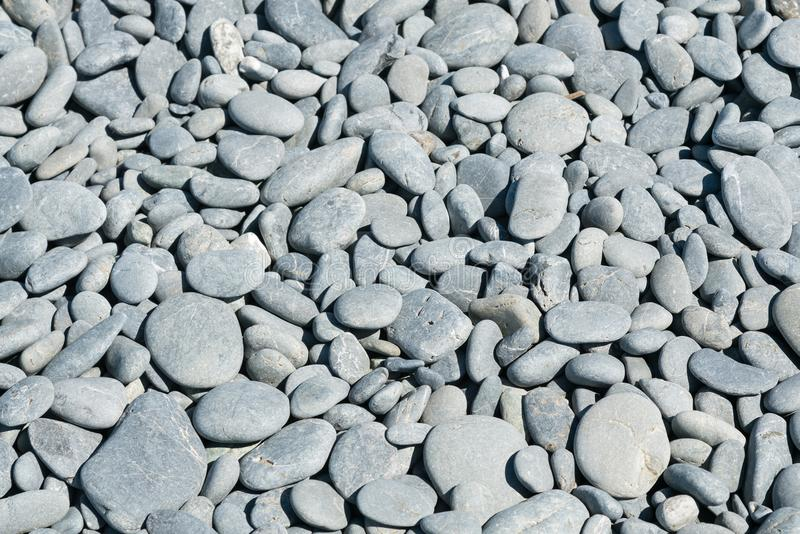 Sea stone round shape on ground. Natural background stock images