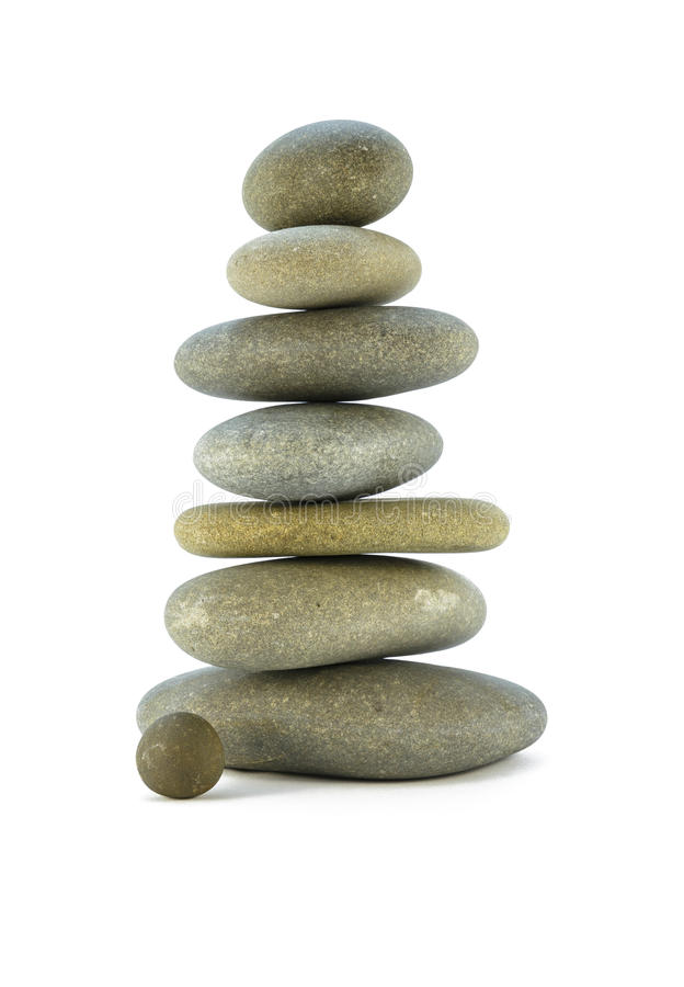 Sea stones stacked tower symbolizing balance stock photography