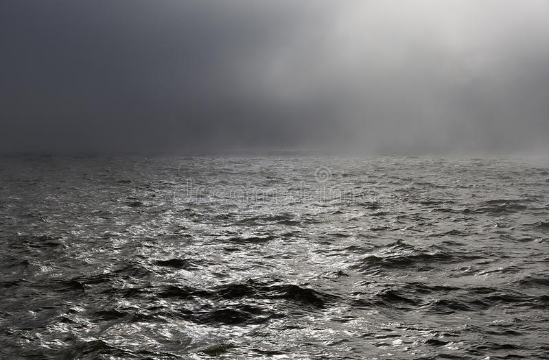 Sea storm in fog royalty free stock photo