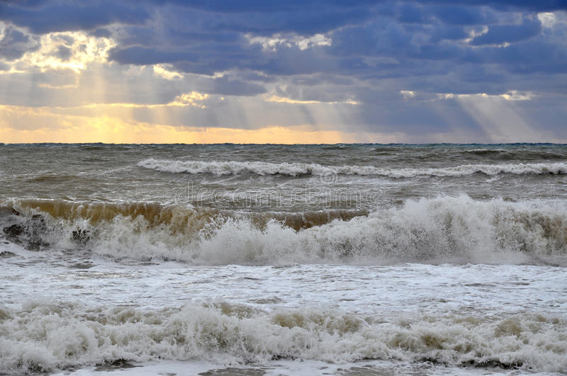 Sea storm in the sunlight stock photography