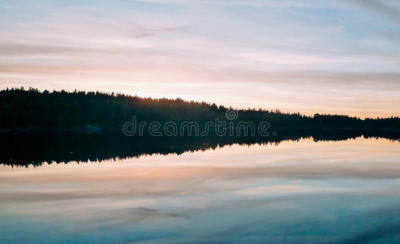 sunset near a lake in Sweden royalty free stock photos