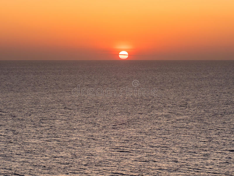 The Sea and the Sun. Sunset in Formentera seen from the Barbaria Cape stock images