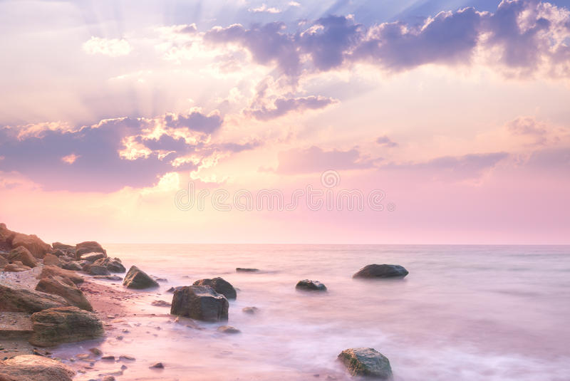 Sea - Sunrise landscape over beautiful rocky coastline. Sunrise landscape over beautiful rocky coastline in the Sea with sunbeams and clouds royalty free stock photos