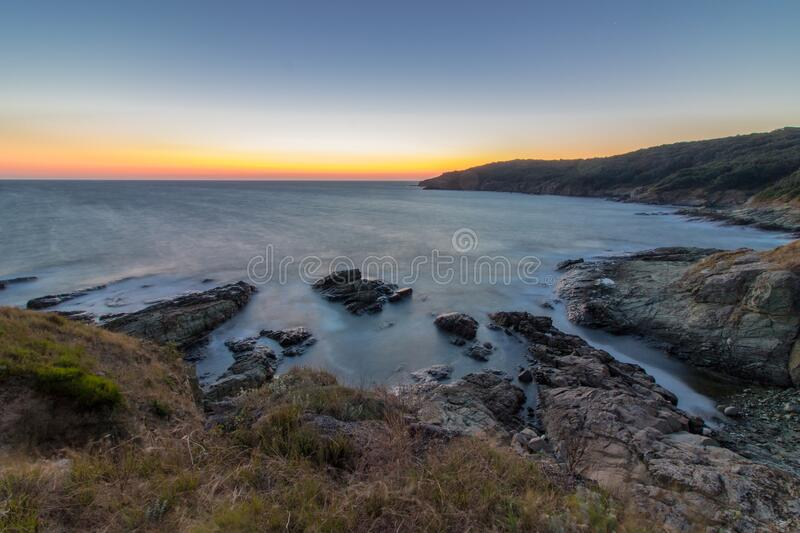 Sea sunrise at rocky beach. royalty free stock images