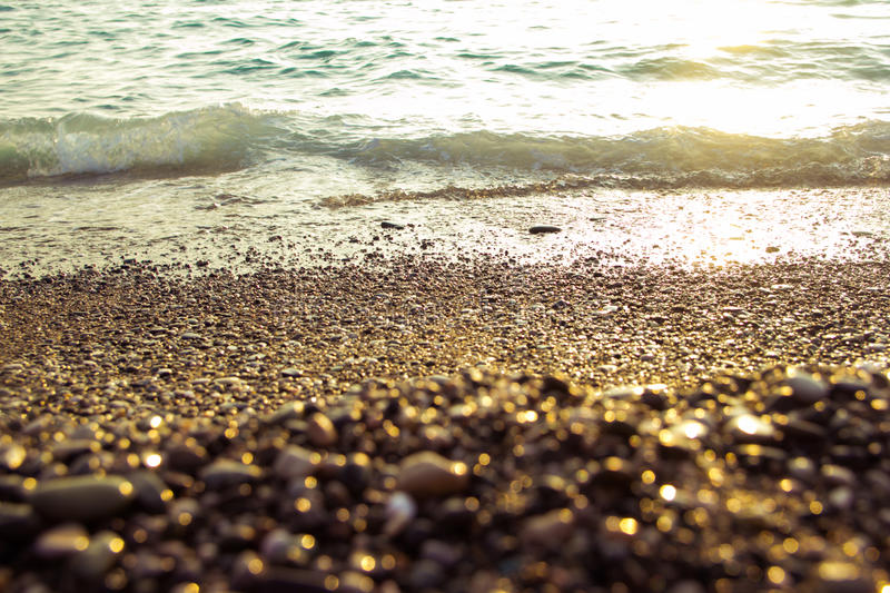 Sea at sunset. As a background of Golden sunlight stock image