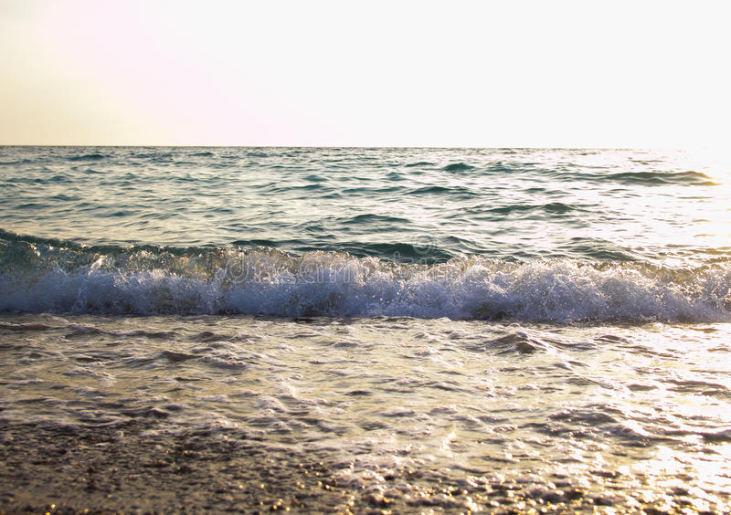 Sea at sunset. As a background of Golden sunlight stock images