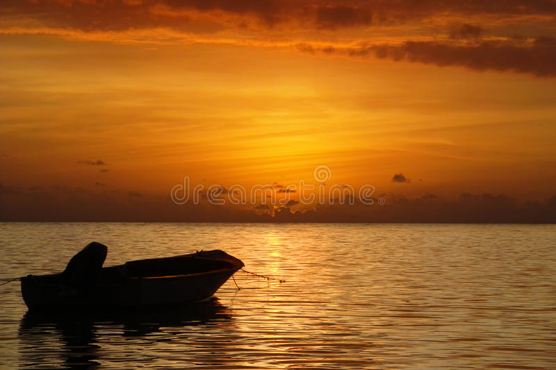 Sea sunset and boat. Beautiful sea sunset and boat royalty free stock photos