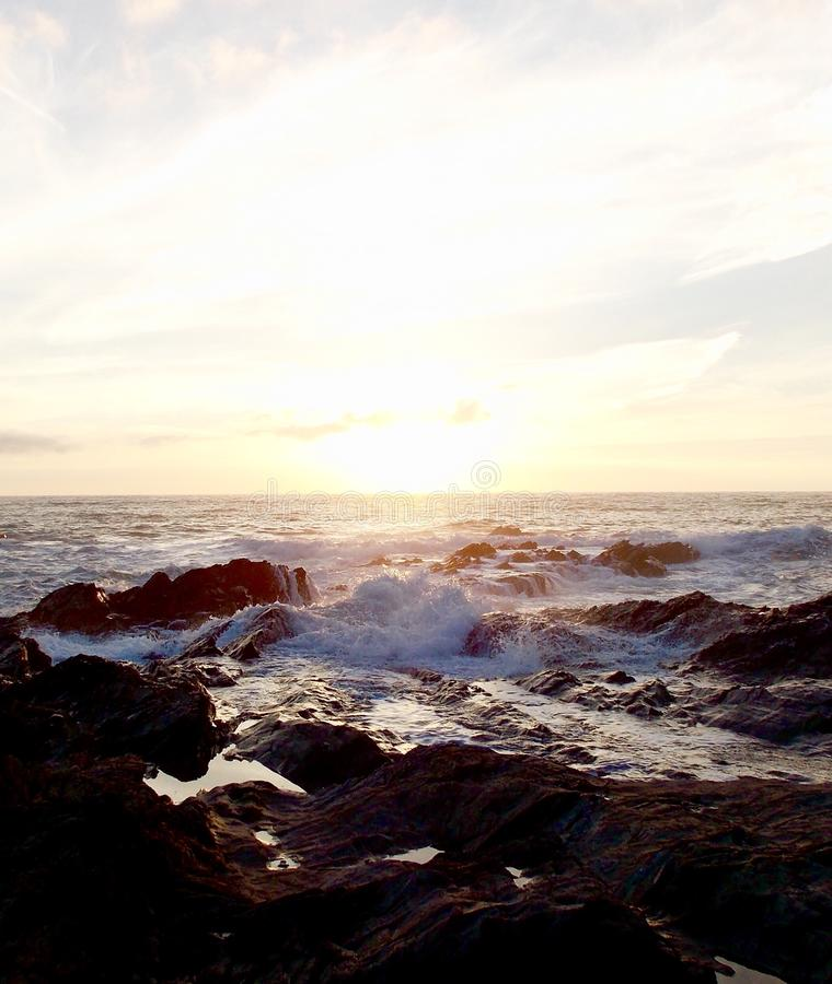 Sea at sunset coastal waves royalty free stock photography