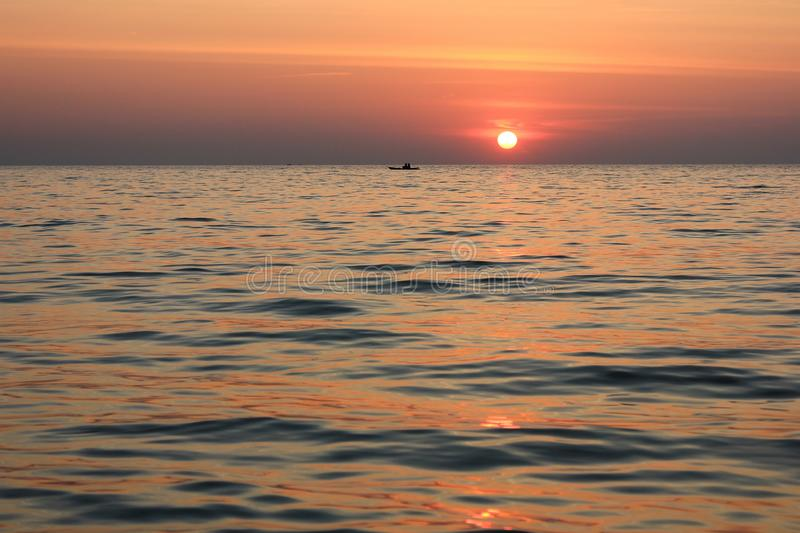 Sea and sunset royalty free stock photo