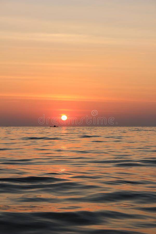 Sea and sunset stock photography