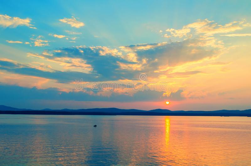 Sea sunset landscape. Sea water surface lit by sunset light. Summer sunny water scene in picturesque tones royalty free stock photo