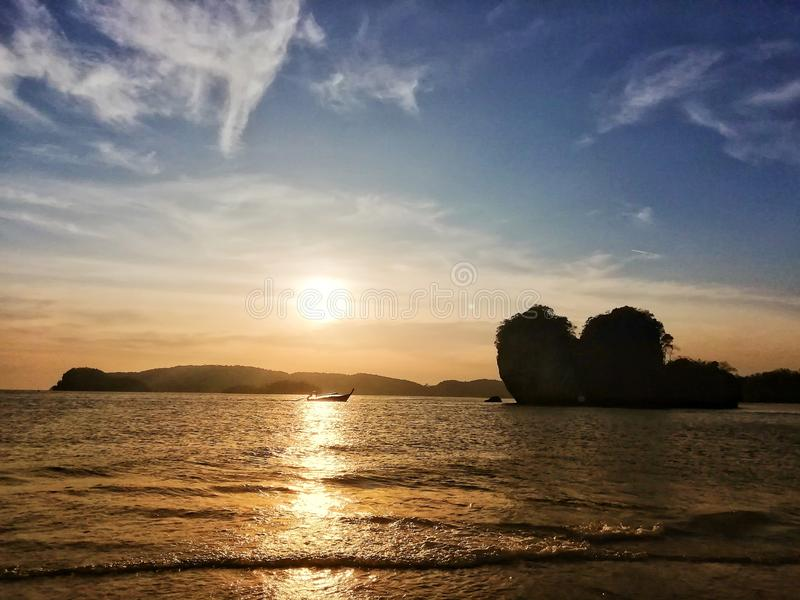 The sea at sunset. The last light of the day and the heart-shaped stone is the most romantic royalty free stock image