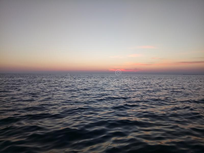 Sea after sunset stock image