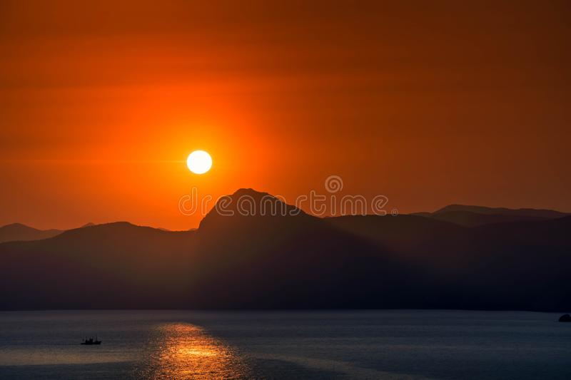 Sea Sunset. Picturesque sunset in the sea bay, ocean, sunrise, water, sky, nature, horizon, landscape, beach, beautiful, dawn, orange, morning, blue, dusk royalty free stock photography