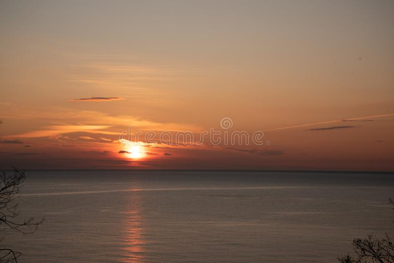 Sea sunset, sea and sky are painted with warm orange shades stock images