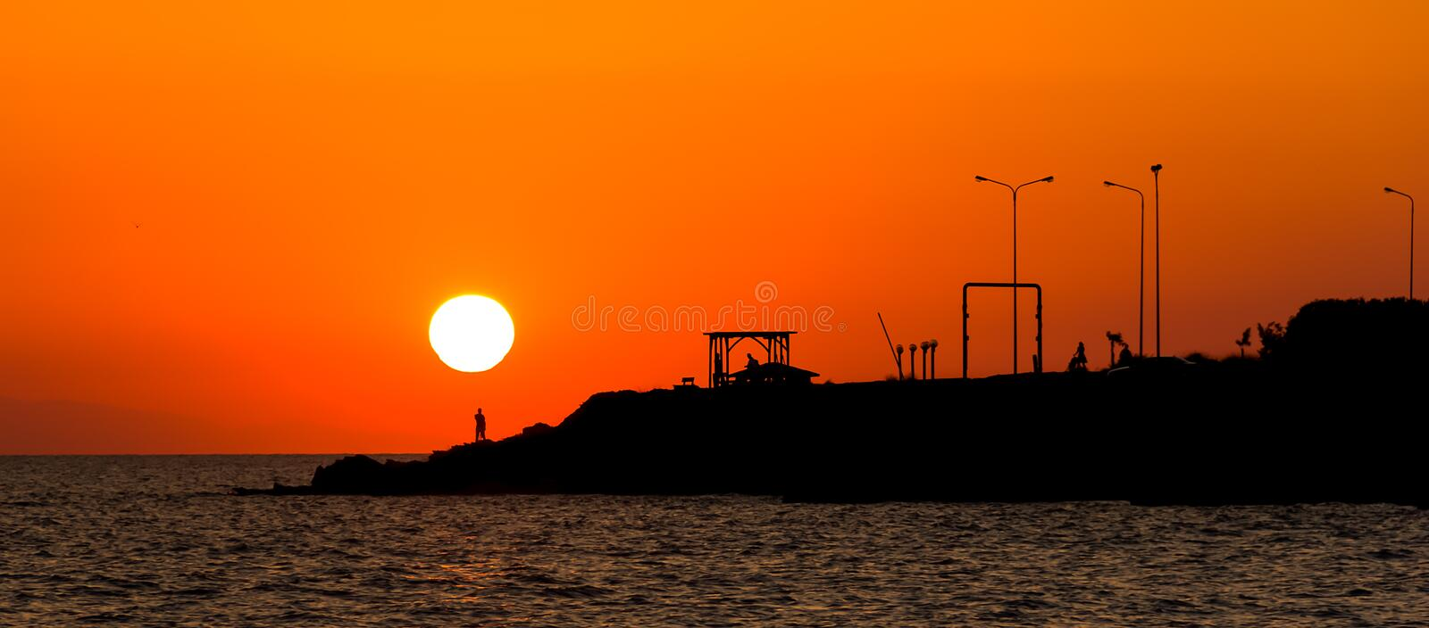 Sea sunset silhouette of Neos Marmaras cast in Greece royalty free stock photo
