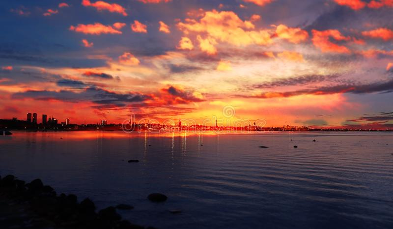 Sunset sea sunlight night sky moon light skyline evening light reflection on seawater gold summer sunset city panorama on horizon. Sea sunset sunlight night sky royalty free stock photography