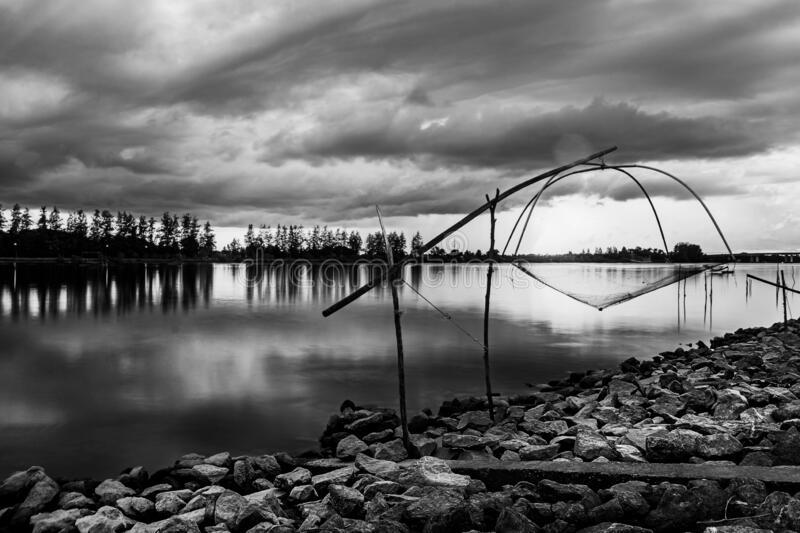 Sea sunset or sunrise with fishing tool countryside and colorful of sky in twilight, Black and white and monochrome style stock photos