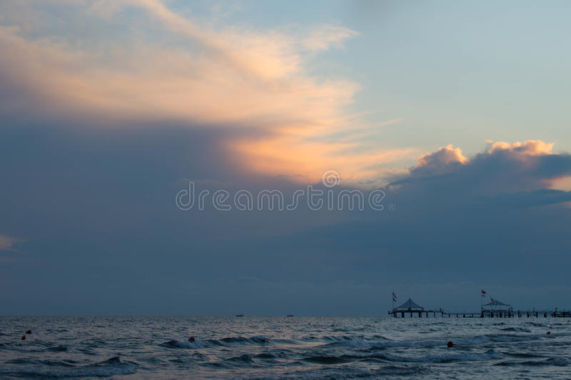 Sea at sunset. Vanilla sky. A beautiful rich sunset to the sea. In the distance are houses stock images