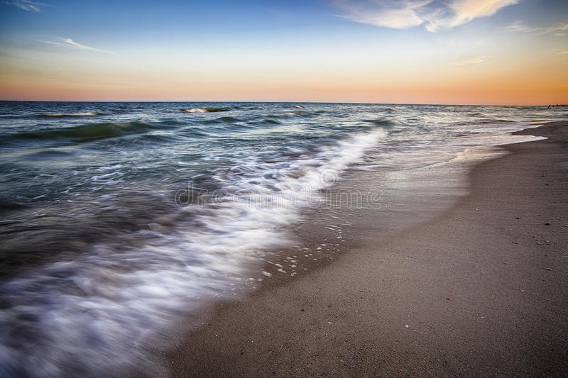 Sea surf wave photographed with long exposure royalty free stock images