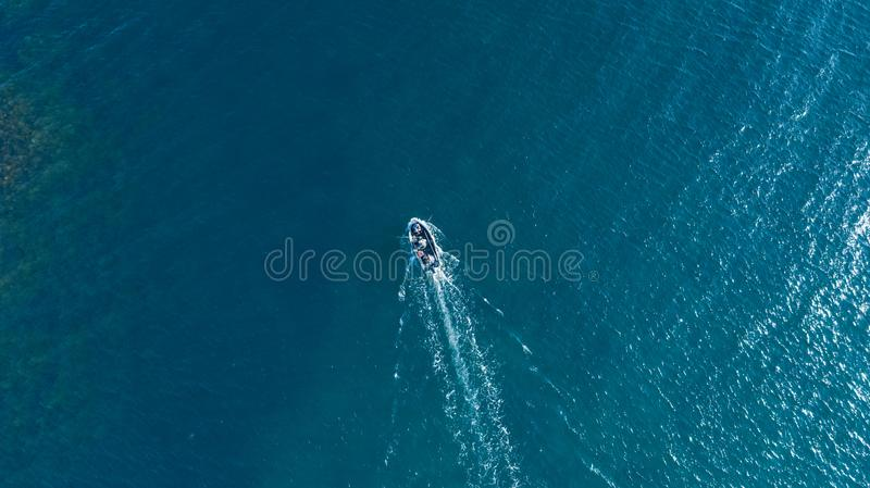 Sea surface with boat aerial view royalty free stock photography