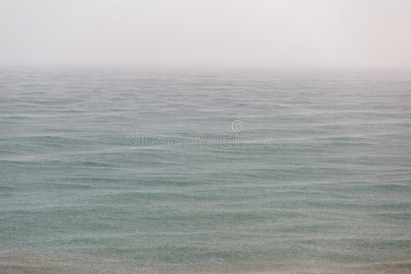 Sea surface on a rainy day as a background or backdrop royalty free stock image