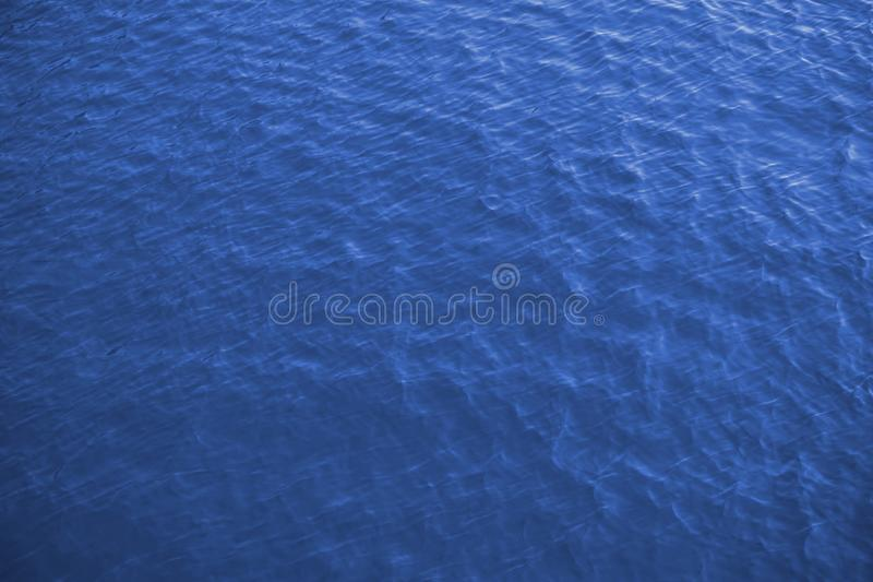 Sea surface aerial view, blue background. Sea surface with small waves aerial view, royal blue background stock images