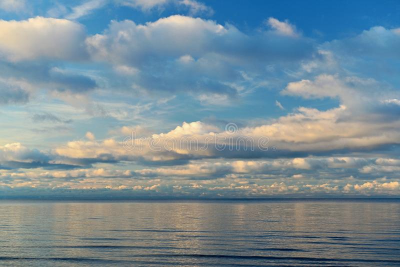 Sea surface under the blue sky. The Baltic Sea is under the blue sky with beautifull clouds,marine stock photography