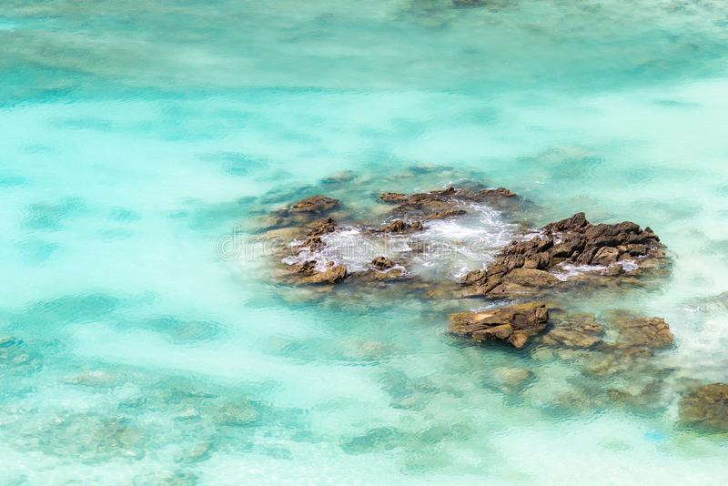 Sea surface wit rock aerial stock photo