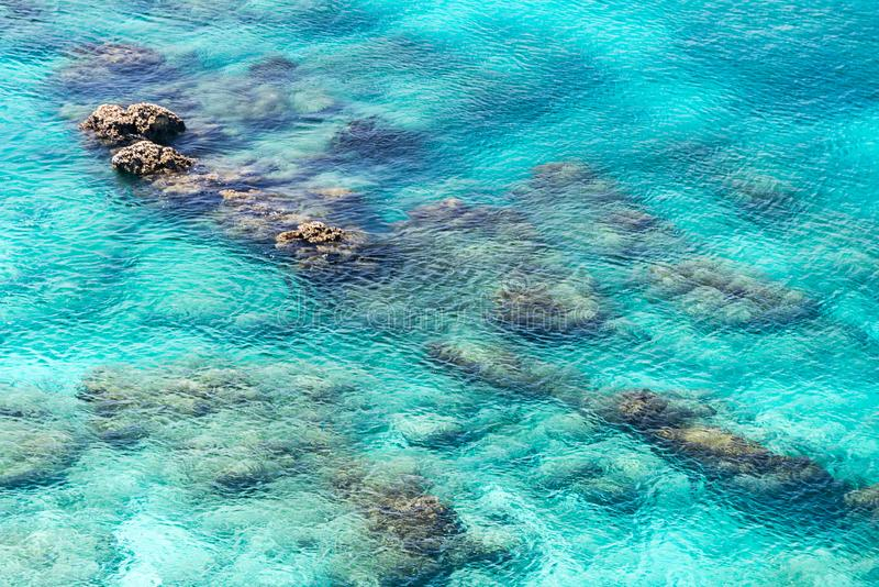 Sea surface wit rock aerial royalty free stock images