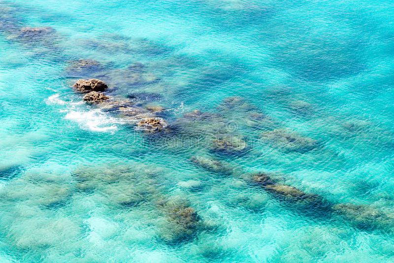 Sea surface wit rock aerial stock photography