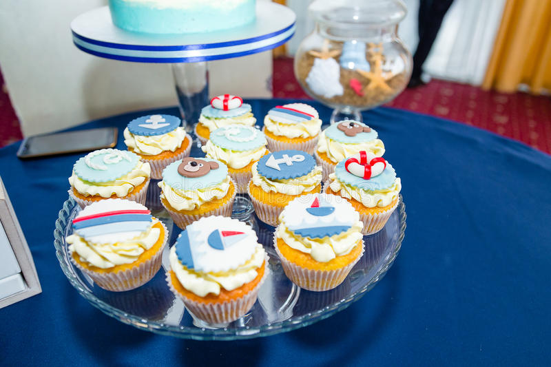 Sea thematic cupcakes. On the table royalty free stock photos