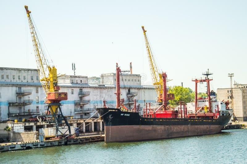 Sea Trade Port. Container terminal. Cranes, cargo ships. Horizon royalty free stock images