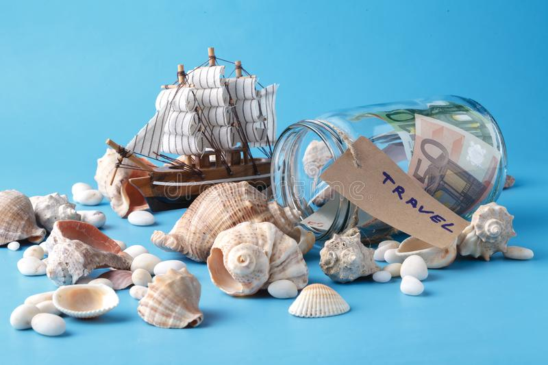 Sea travel in vacation concet with shell and ship royalty free stock photography